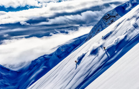 Lynsey Dyer, Josh Daiek, and Guide Michael Brackenhofer skiing at Last Frontier Heli