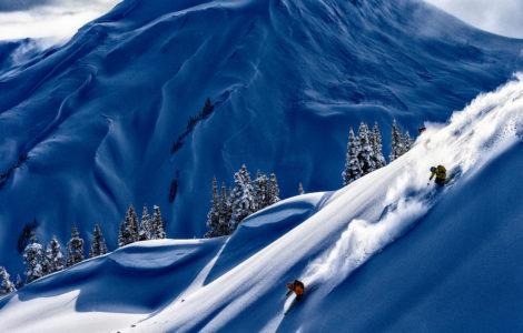 Lynsey Dyer, Josh Daiek, and Guide Michael Brackenhofer skiing at Last Frontier Heli