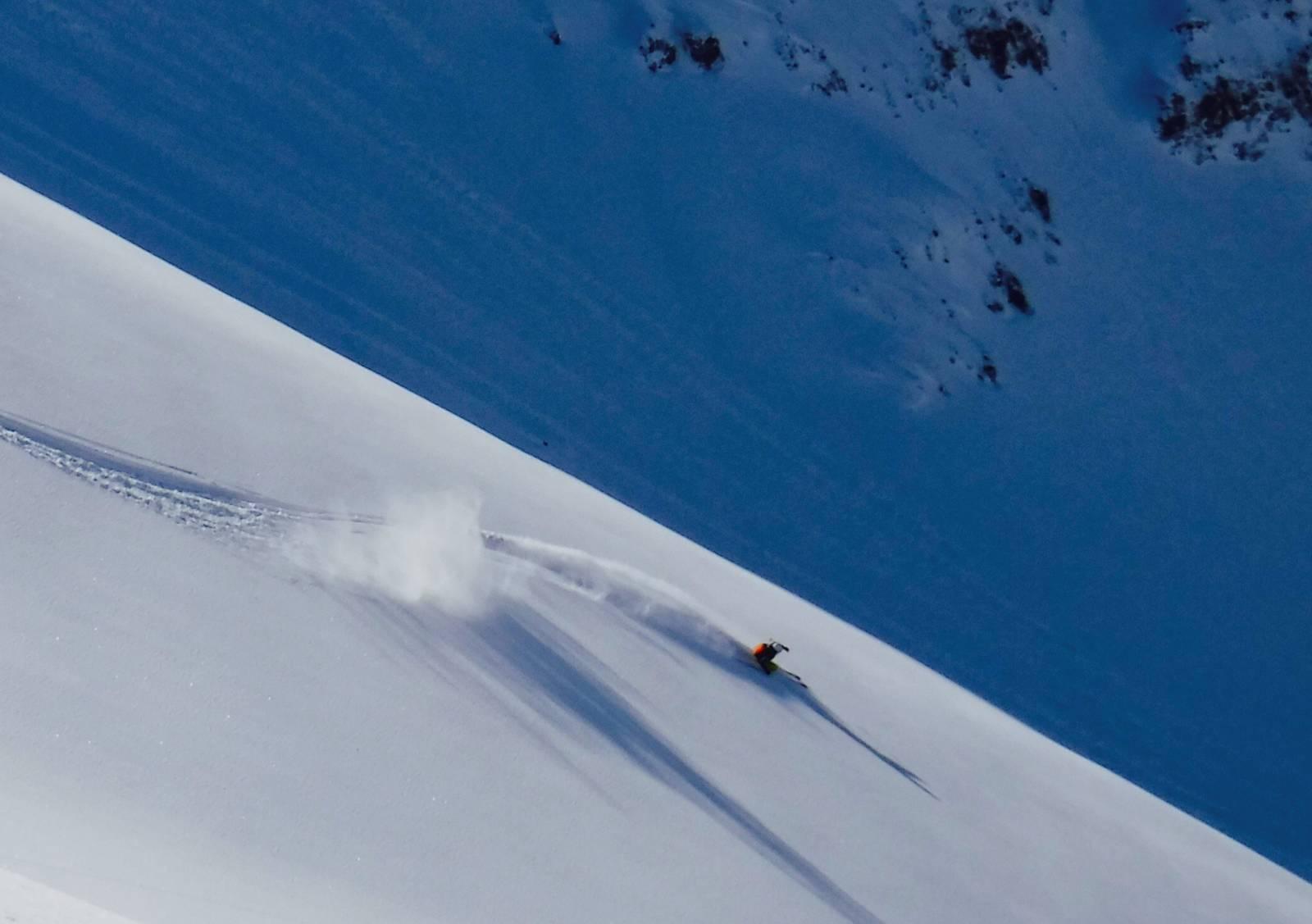 heliski island , skier full speed